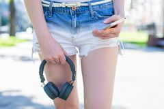 Social media marketing teen generation teenager concept. Cropped closeup view photo of pretty legs hand holding using getting. Receiving sending sms message stock images