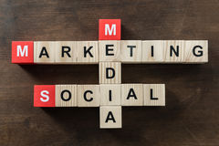 Social media marketing word made from crossword. On wooden surface Royalty Free Stock Image