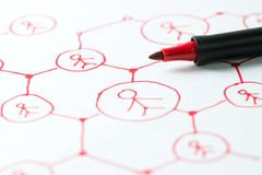 Social media network diagram. Social media network or people communication diagram drawn on paper using red color pen royalty free stock photography