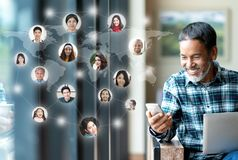Social media network,  Global network connection and people connecting all over the world map. Smiling happy mature man using. Smartphone serving internet royalty free stock photos
