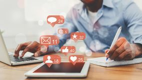 Social media notifications. Man working on laptop royalty free stock photography