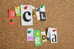 Social media. Single letters pinned on cork noticeboard Royalty Free Stock Photos