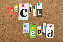 Social media. Single letters pinned on cork noticeboard Stock Photos