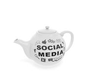 Social media teapot. Social media network marketing online concept: teapot with web icons and word as symbol of human communication on internet using social Royalty Free Stock Photos
