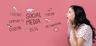 Social media theme with young woman speaking. On a pink background stock photography
