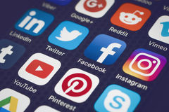 Social media. Are trending and both business as consumer are using it for information sharing and networking. Showing  icons on smartphone Royalty Free Stock Photos