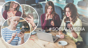 Social media.Two young women sitting at table in cafe, drinking coffee and using laptop. Stock Photos