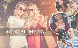 Social media.Two young women stand outside and use smartphone.Girls with smartphones. Stock Photography