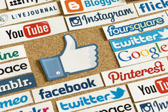 Social media website logos Facebook, Twitter and other with like logo printed on paper and pinned on cork. BELGRADE - JUNE 17, 2014 Social media website logos stock images