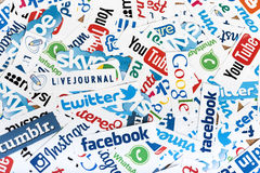 Social media website logos Facebook, Twitter and other printed on paper Stock Photo