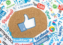 Social media website logos Facebook Twitter and other printed on paper with like icon on cork bulletin bo. BELGRADE - JUNE 17, 2014 Social media website logos Royalty Free Stock Photography
