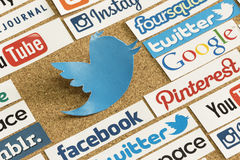 Social media website logos Facebook, Twitter and other printed on paper and pinned on cork bulletin board Stock Photography
