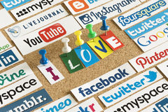 Social media website logos Facebook, Twitter and words I love printed on paper and pinned on cork bulleti Royalty Free Stock Photography