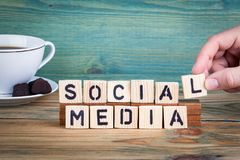 Social media. Wooden letters on the office desk, informative and communication background.  Royalty Free Stock Photo