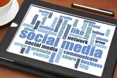 Social media word cloud on tablet. Social media concept - word cloud on a digital tablet tablet with a cup of tea stock image