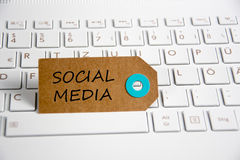 Social media. Written on paper tag on a keyboard stock photo