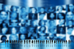 Social network. Silhouette of peoples standing with screen of people faces behind Royalty Free Stock Photography