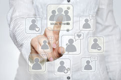 Social network. Woman pressing social network button with one hand Stock Photography
