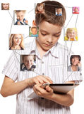 Social Network. Kids in social network. Child looks to the tablet computer. Social group Royalty Free Stock Photo