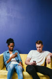 Social network addiction concept. Couple conflict. Stock Photography