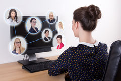 Social network concept - beautiful business woman using pc with Royalty Free Stock Photos