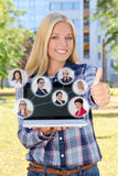 Social network concept - beautiful woman with laptop thumbs up i Royalty Free Stock Photos