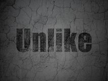 Social network concept: Unlike on grunge wall background. Social network concept: Black Unlike on grunge textured concrete wall background Royalty Free Stock Images