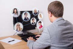 Social network concept - business man using computer in office Stock Photo