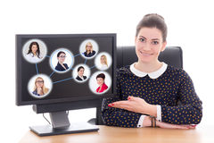Social network concept - business woman sitting in office and sh Royalty Free Stock Photo
