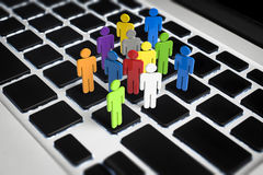 Social network concept. With 3d rendering group of people on keyboard Stock Images