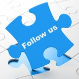 Social network concept: Follow us on puzzle background. Social network concept: Follow us on Blue puzzle pieces background, 3D rendering Royalty Free Stock Photography