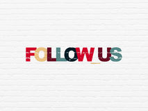 Social network concept: Follow us on wall background Royalty Free Stock Photography