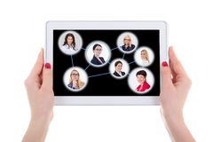 Social network concept - modern tablet pc with people portraits Stock Image