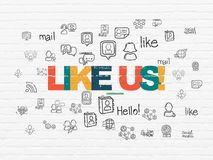 Social network concept: Like us! on wall background Royalty Free Stock Images