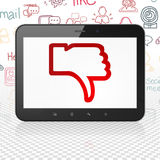 Social network concept: Tablet Computer with Thumb Down on display Royalty Free Stock Photos