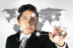 Social network concept on world map. Man press one point of social network concept on world map Stock Photo
