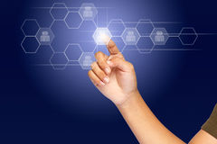 Social network. A hand click on illuminated hexagon touchscreen button, social network concept royalty free stock photo