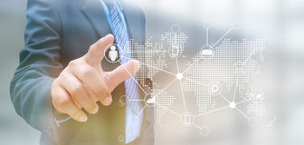 Social network. Hand pushing social network button on a touch screen interface Stock Image