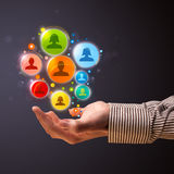 Social network icons in the hand of a businessman Stock Image