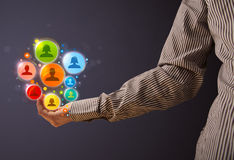 Social network icons in the hand of a businessman Royalty Free Stock Image
