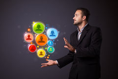 Social network icons in the hand of a businessman Royalty Free Stock Photo