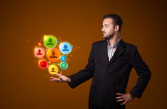 Social network icons in the hand of a businessman Stock Photos