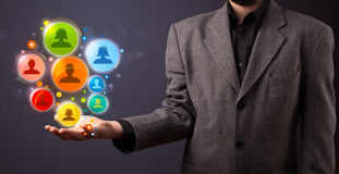 Social network icons in the hand of a businessman Stock Photo