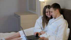 Social network idle leisure laptop communication. Social network addiction. idle leisure and communication. couple using laptop at home before going to sleep stock video footage