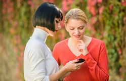 Social network. just look at this. 3g 4g mobile internet surfing. digital marketing two happy women look in phone. buy. Online on cyber monday. black friday stock photo