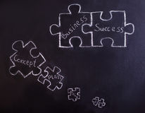 Social network. Man is looking for a new ideas for business. Blackboard with connecting jigsaw pieces Stock Photos