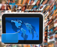 Social network media. A tablet or computer handheld device with speech bubble earth continents illustration with blurred multi race faces Stock Photography