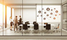 Social network in meeting room. Whiteboard with social network in modern conference room interior with discussing businesspeople, sunlight and New York city view Stock Photos