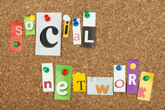 Social network. Single letters pinned on cork noticeboard Stock Photos