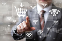 Social network Wifi businessman presses web button shopping cart Royalty Free Stock Photos